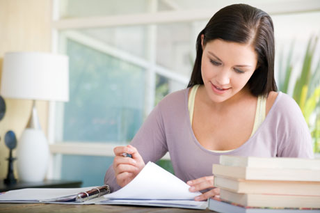 Woman Looking Over Paperwork